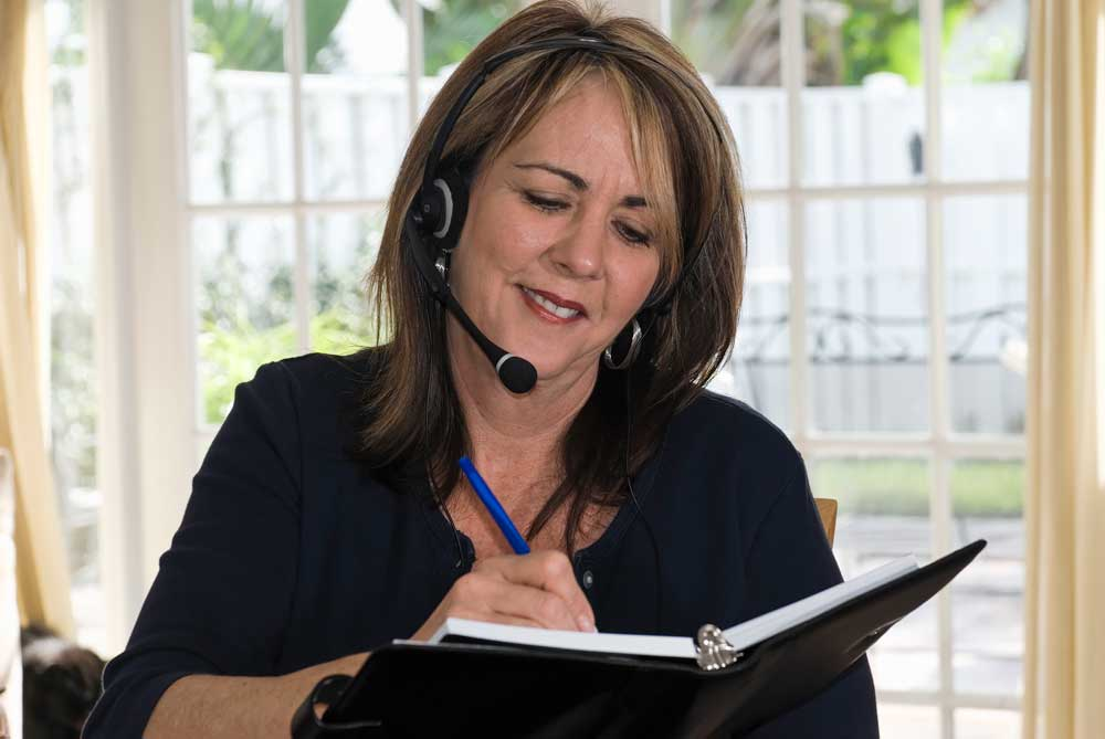 event planner with headset and notebook
