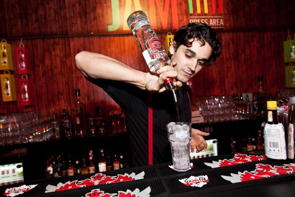 Smirnoff Nightlife Exchange Project barman pouring drink