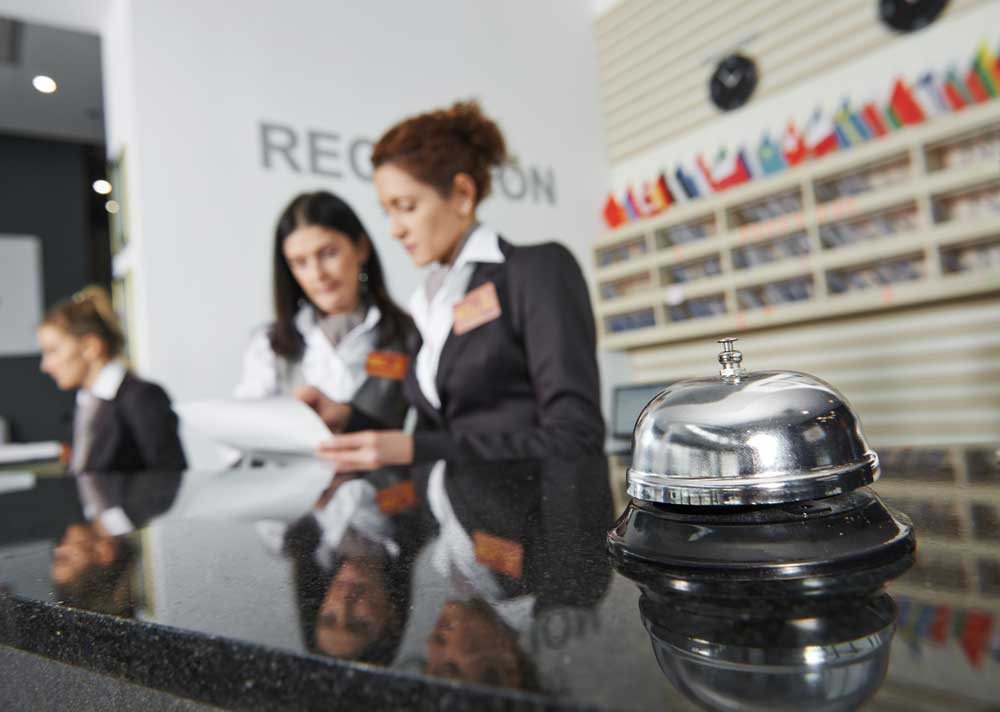 hotel reception desk and staff