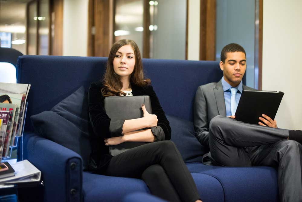 two people waiting at job interview